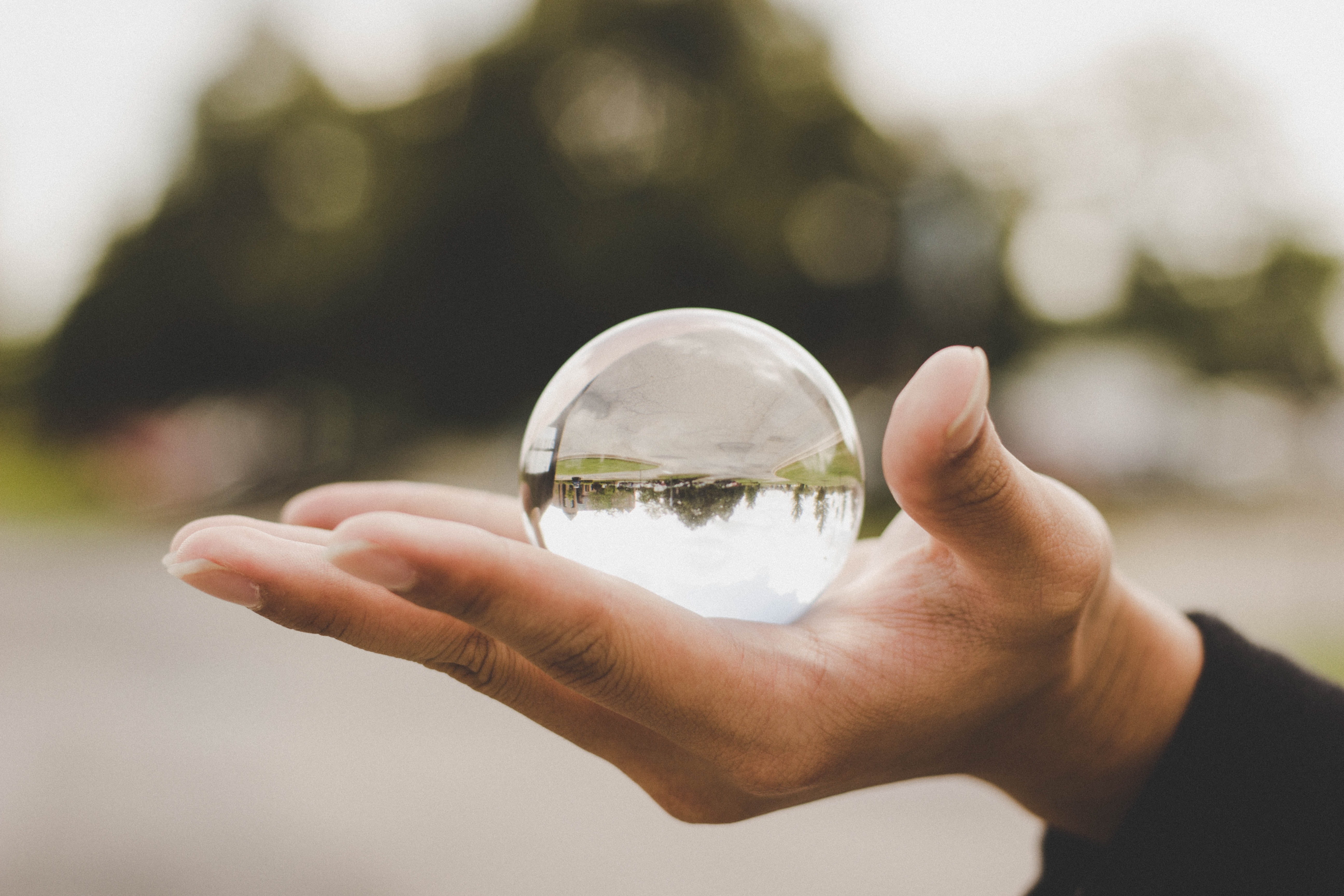 shallow focus photo of glass orb ornament