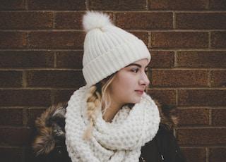 woman wearing white bobble beanie