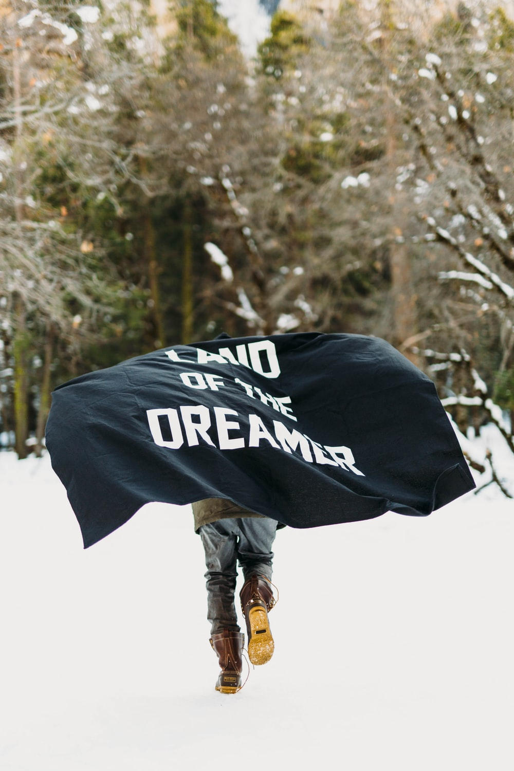 person running on snow with black textile