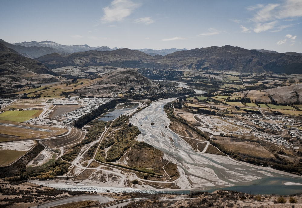 aerial photography of roadway and mountains