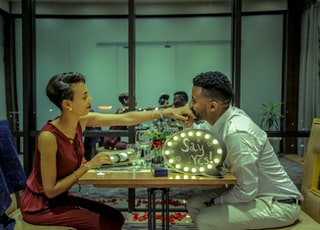 man and woman eating in diner