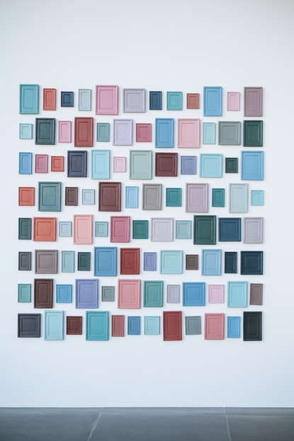 Photo of colourful boards of different sizes on a wall, by Markus Spiske