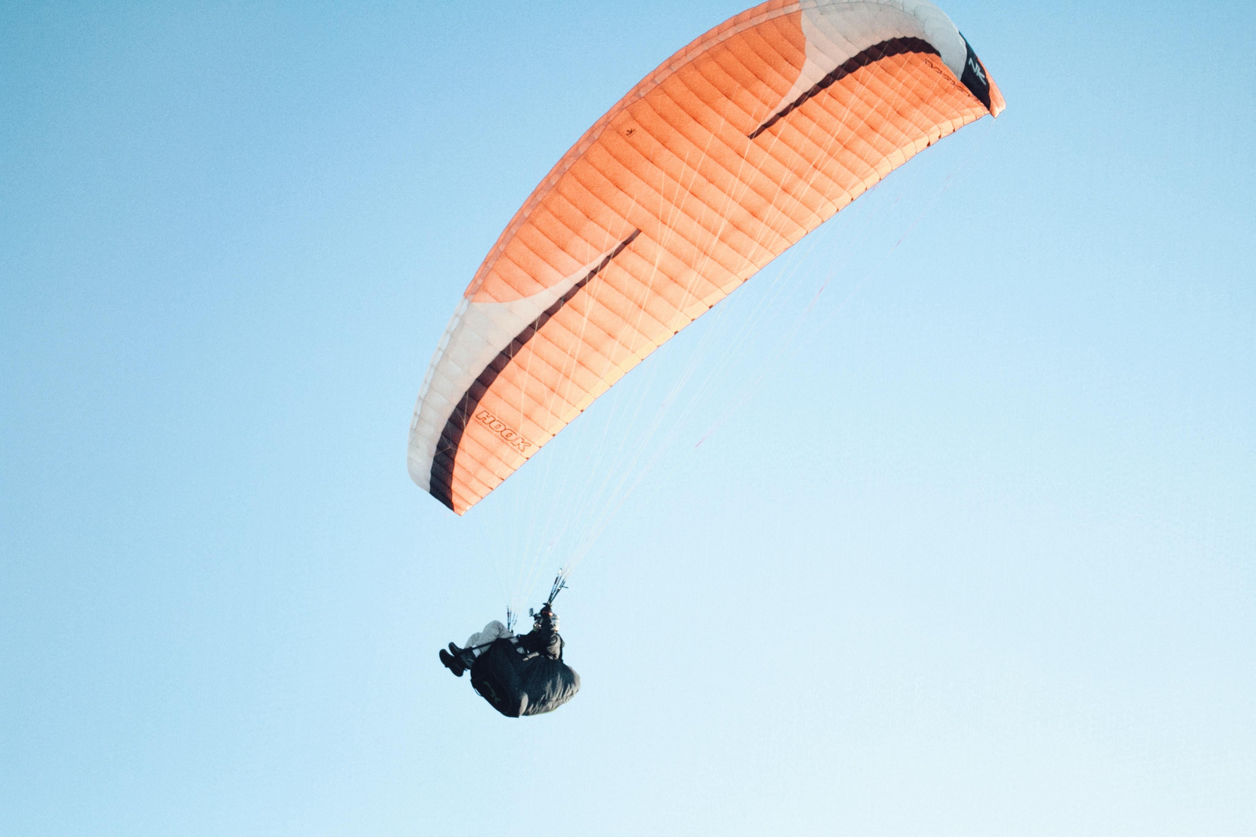 man wearing parachute in sky during daytime