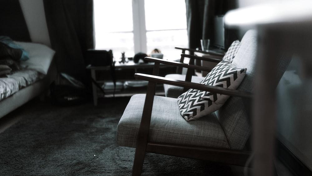 throw pillow on armchair near closed window
