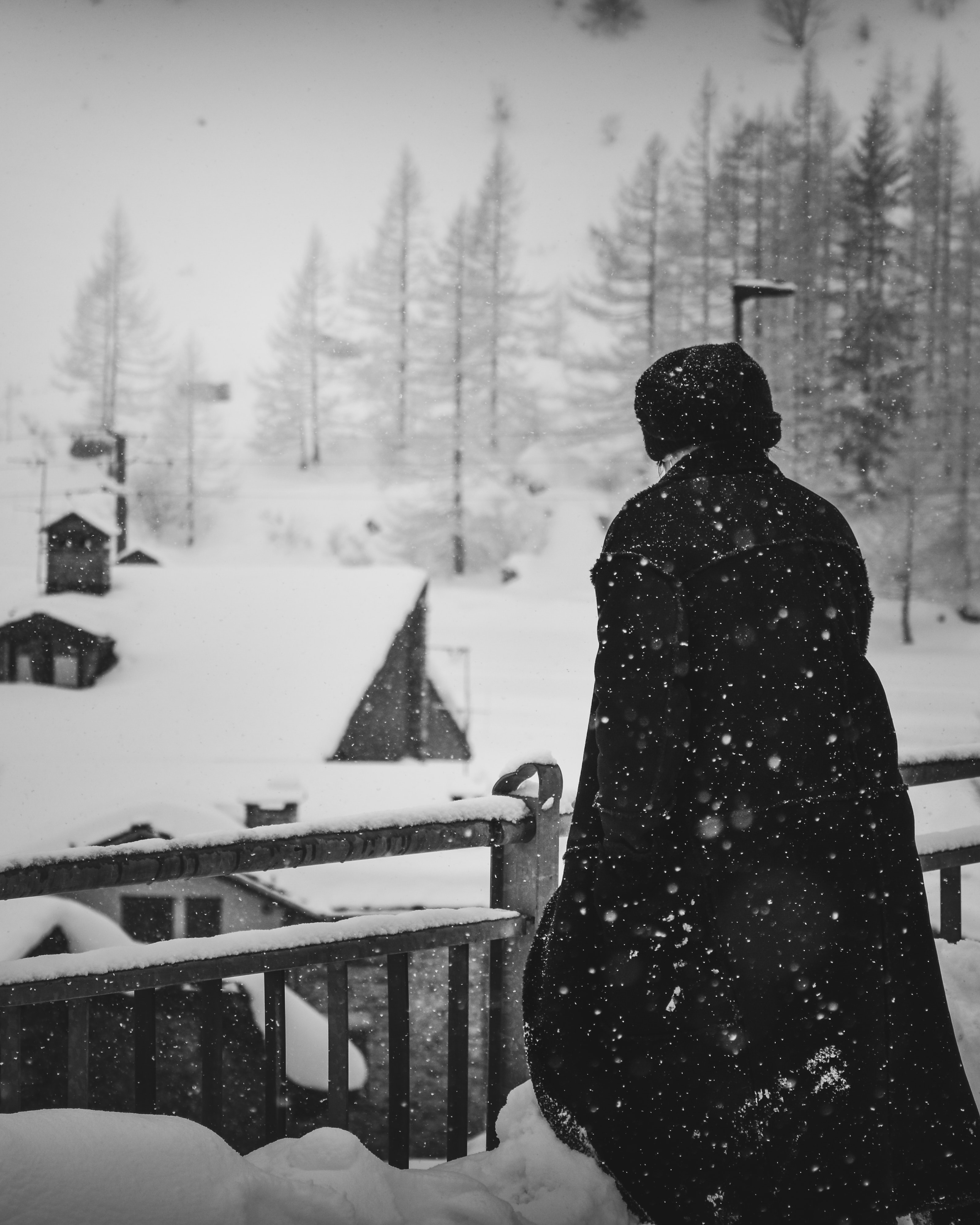 person standing near snow coated houses