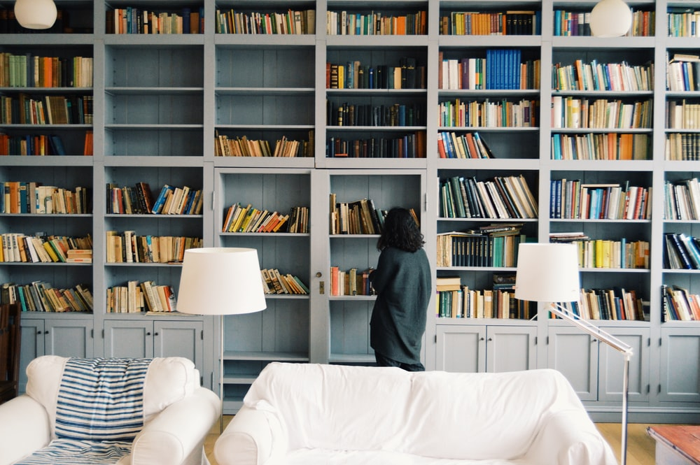 woman finding some book to read