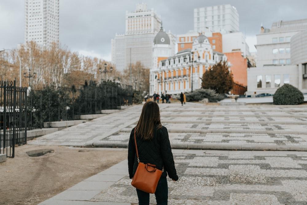 woman looking towards building