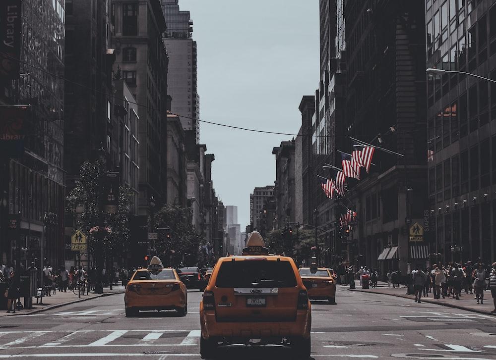 orange vehicle passing on road