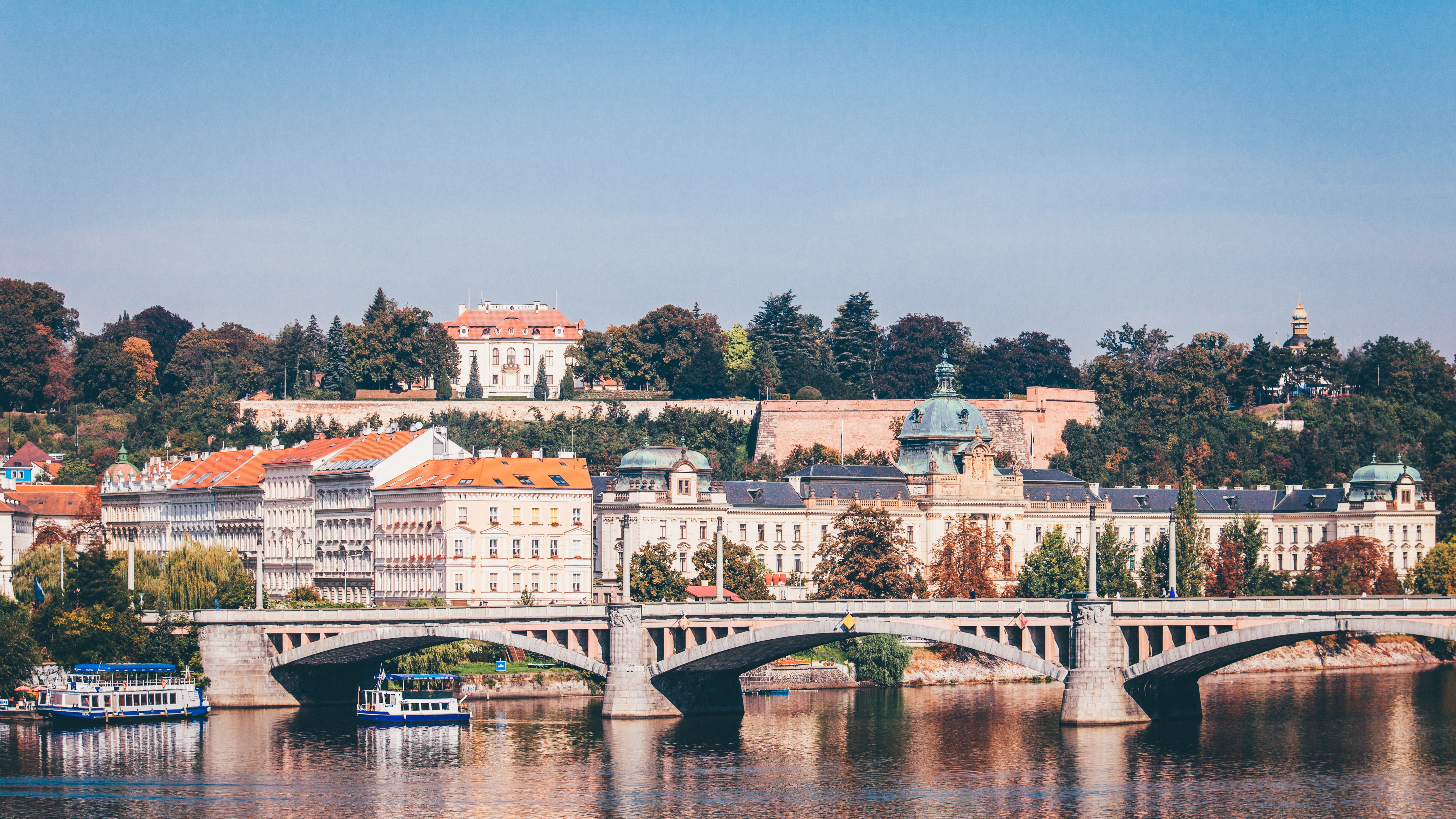 concrete bridge near buildings during daytime