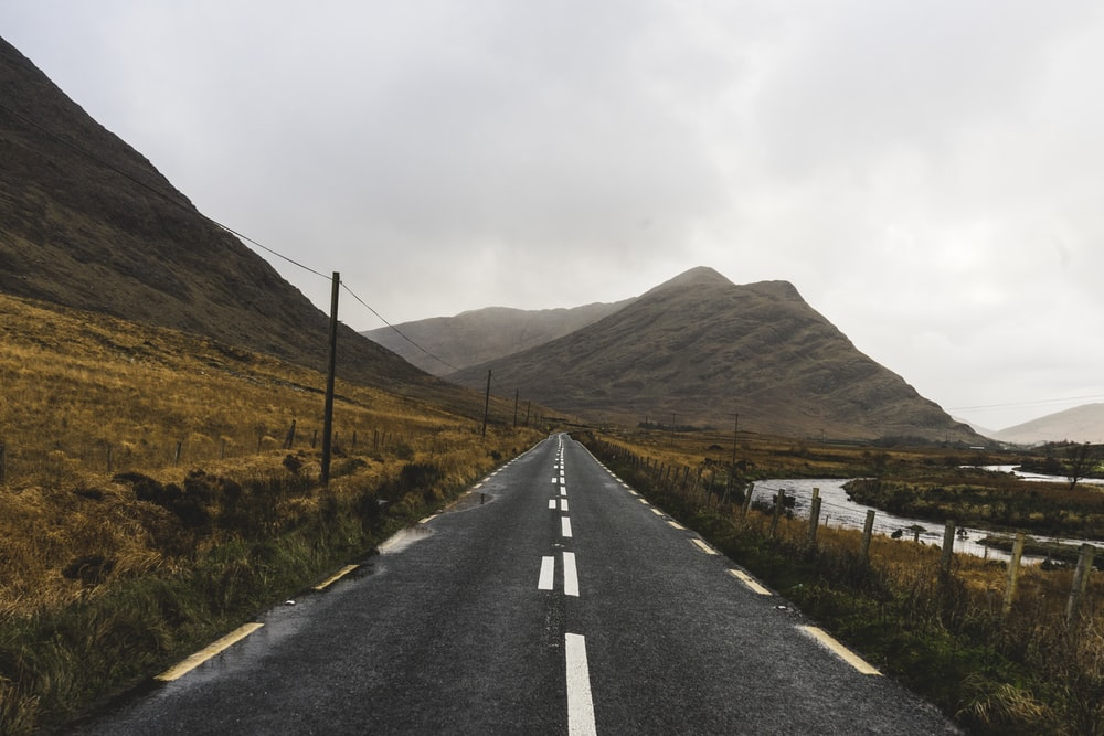 asphalt road during day time