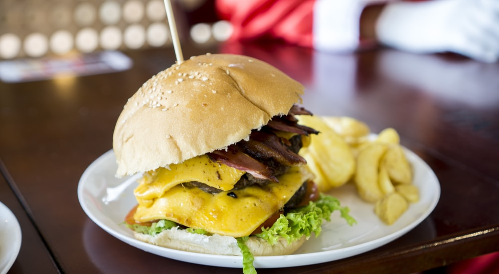 shallow focus photo of bacon and cheese burger