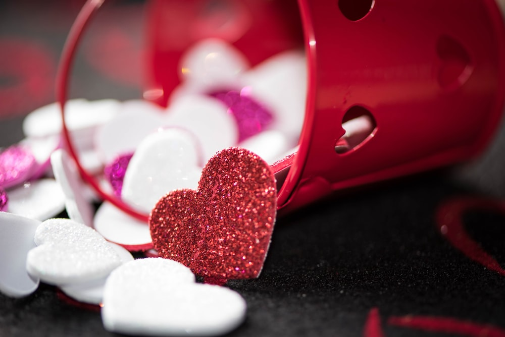 heart decors poured on red bucket