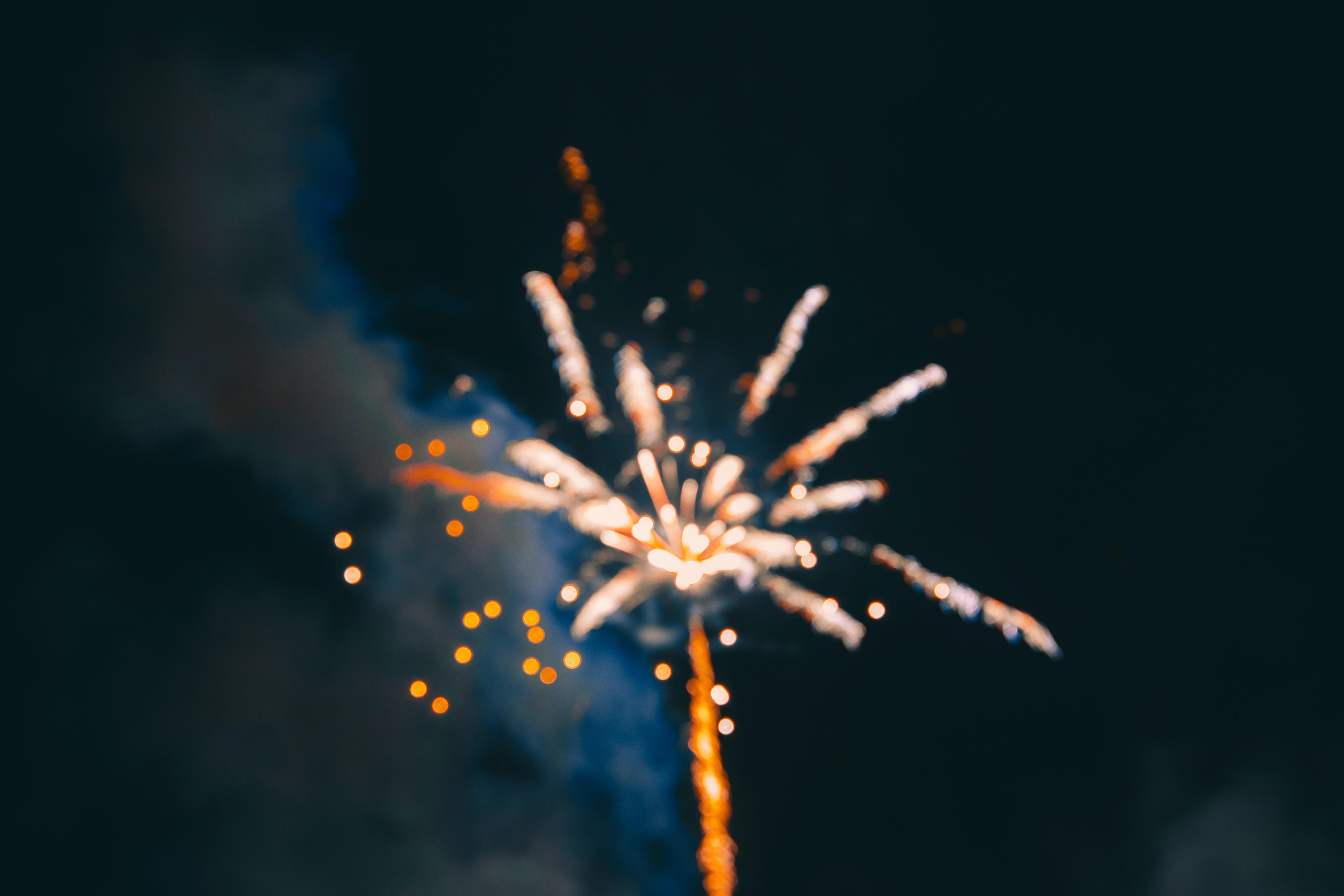 fireworks under cloudy sky