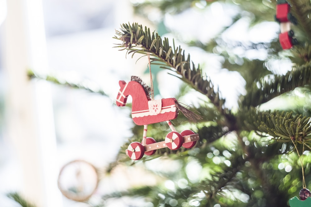 close-up photography of Christmas tree horse decoration