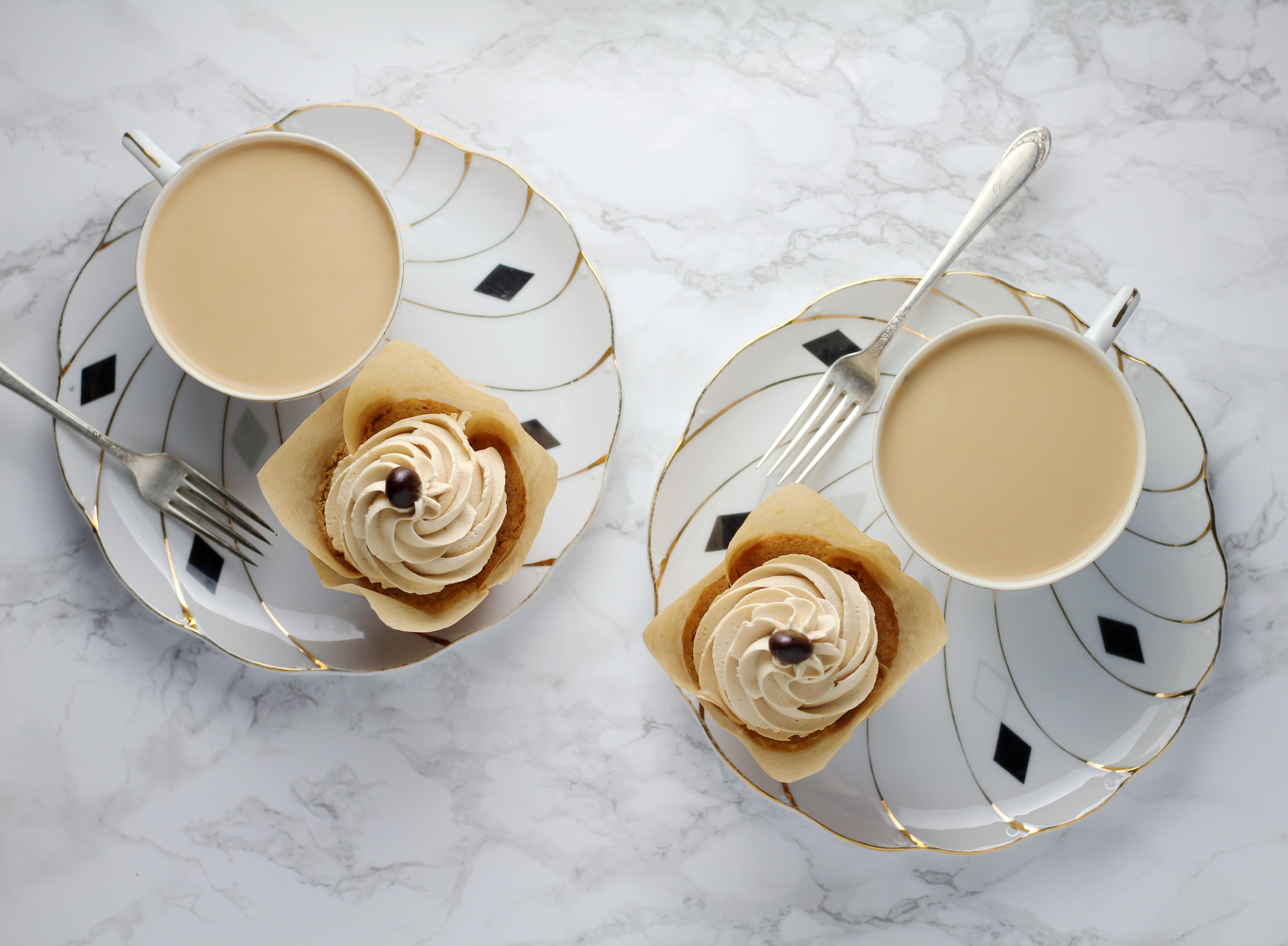flat lay of photography coffee cups on white plates