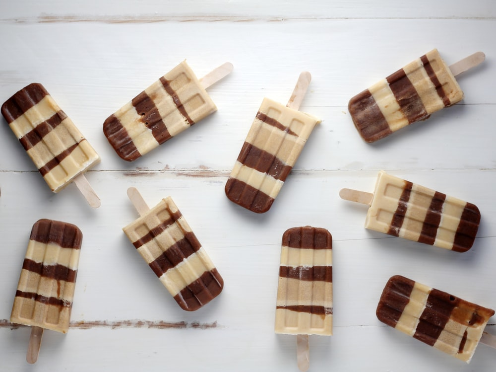 nine brown popsicles