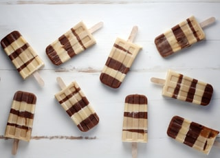 nine brown popsicles