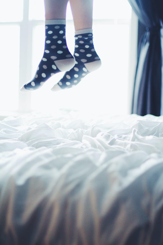 pair of white-and-black polka-dot socks