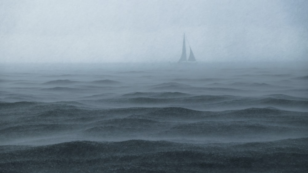 boat sailing in body of water