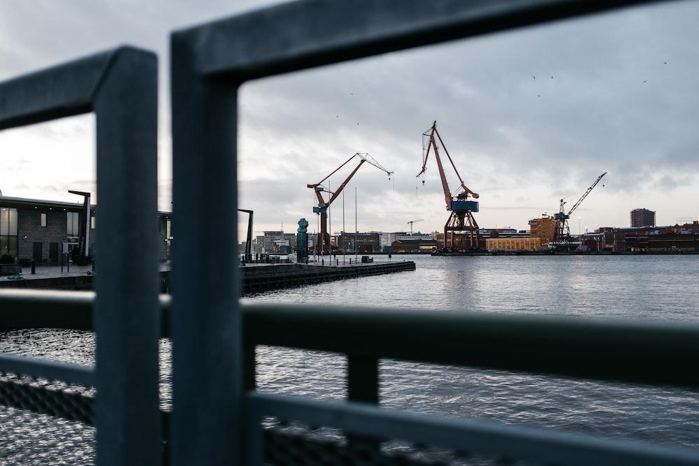 heavy equipment near buildings viewing sea