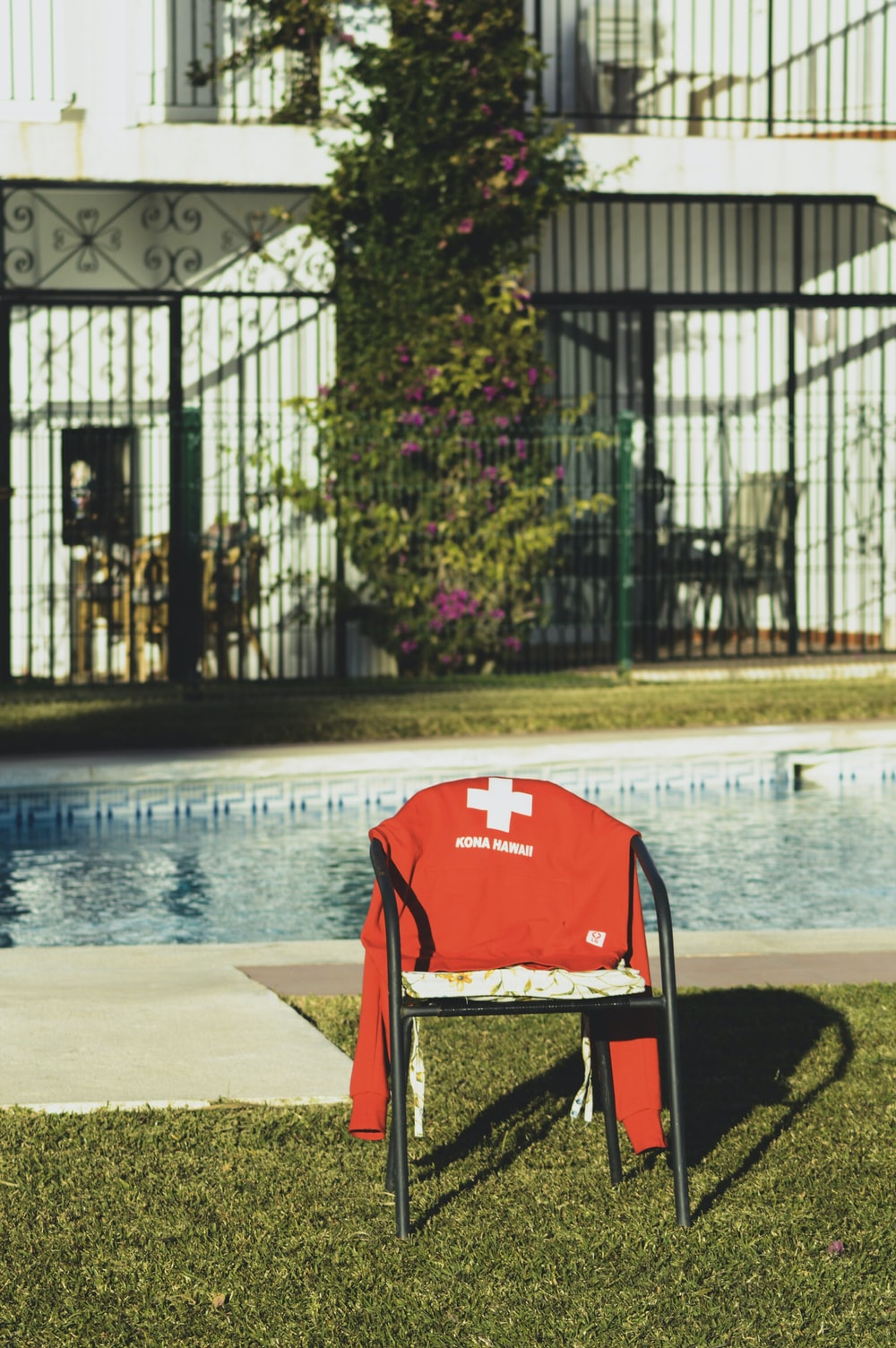 black armchair near pool