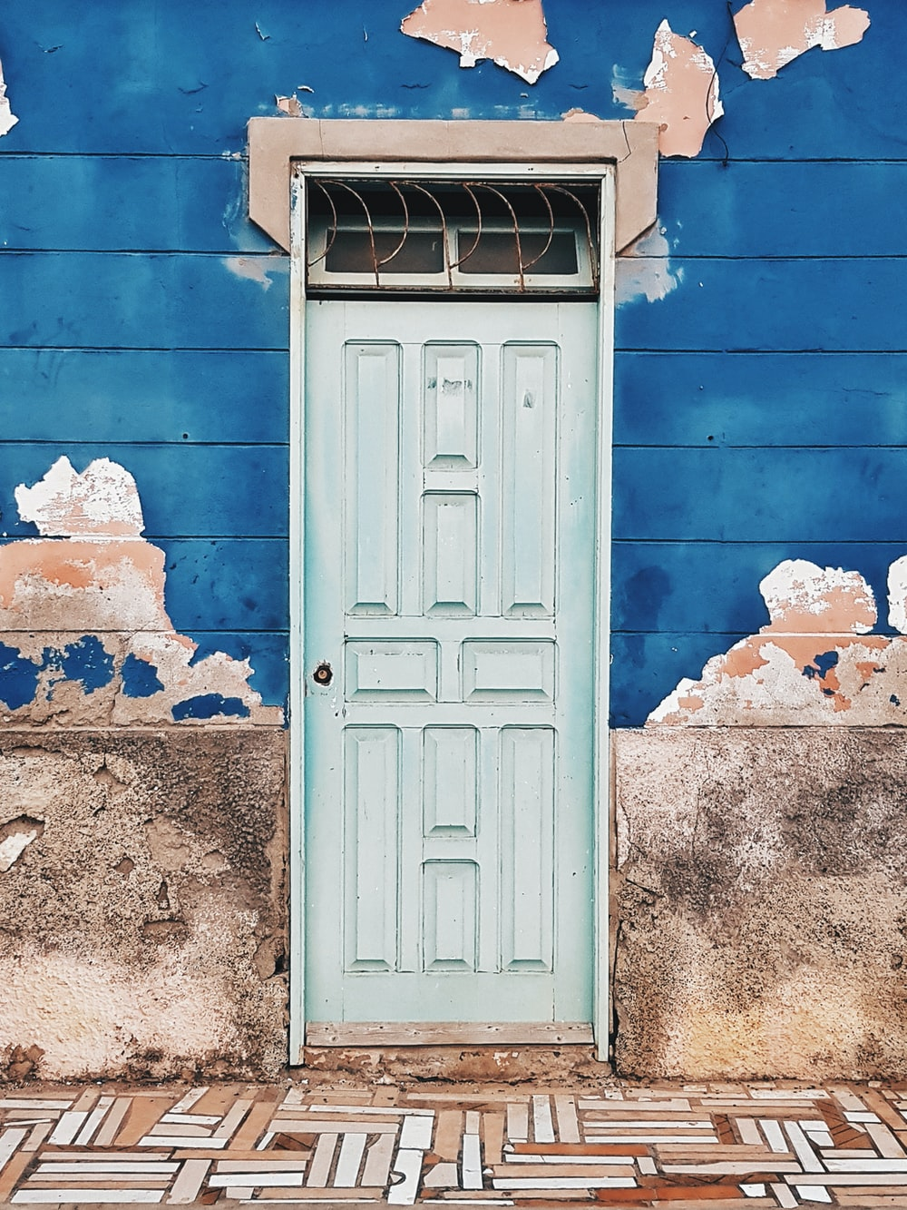 photo of building with white wooden door