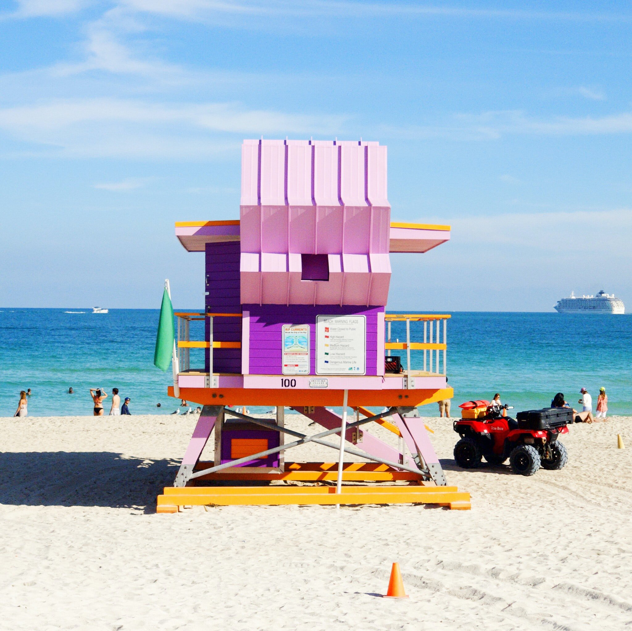 pink and multicolored lifeguard house near ocean at daytime