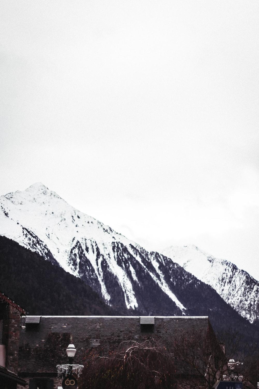 brown house near mountain ranges