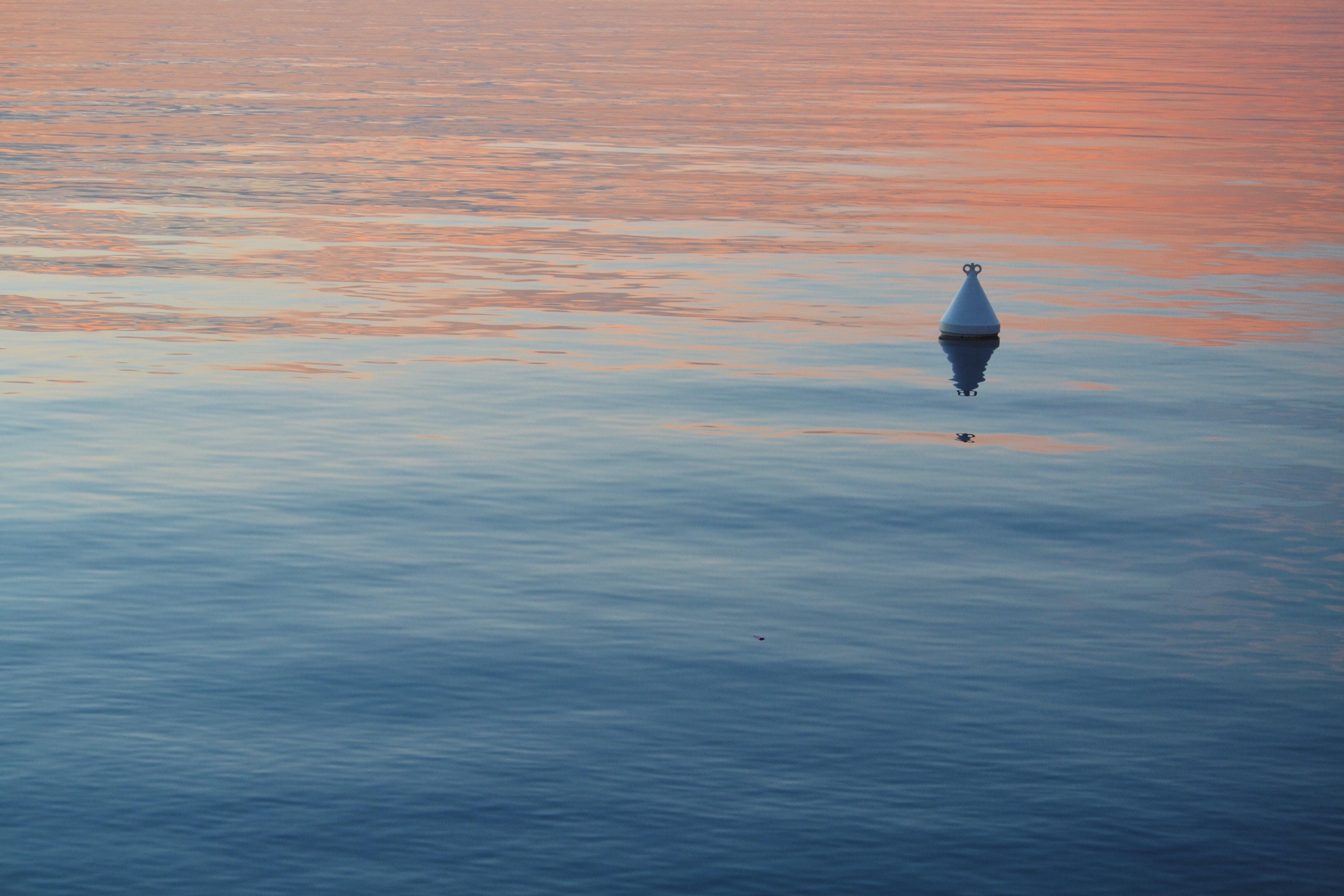 triangular metal floating in water