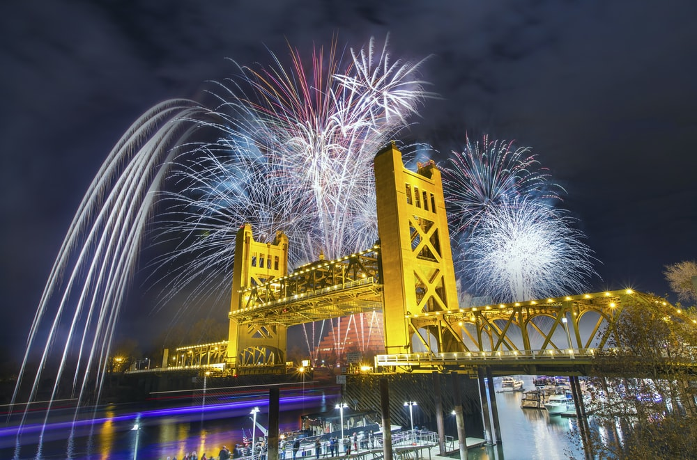 bridge with fireworks during nighttime