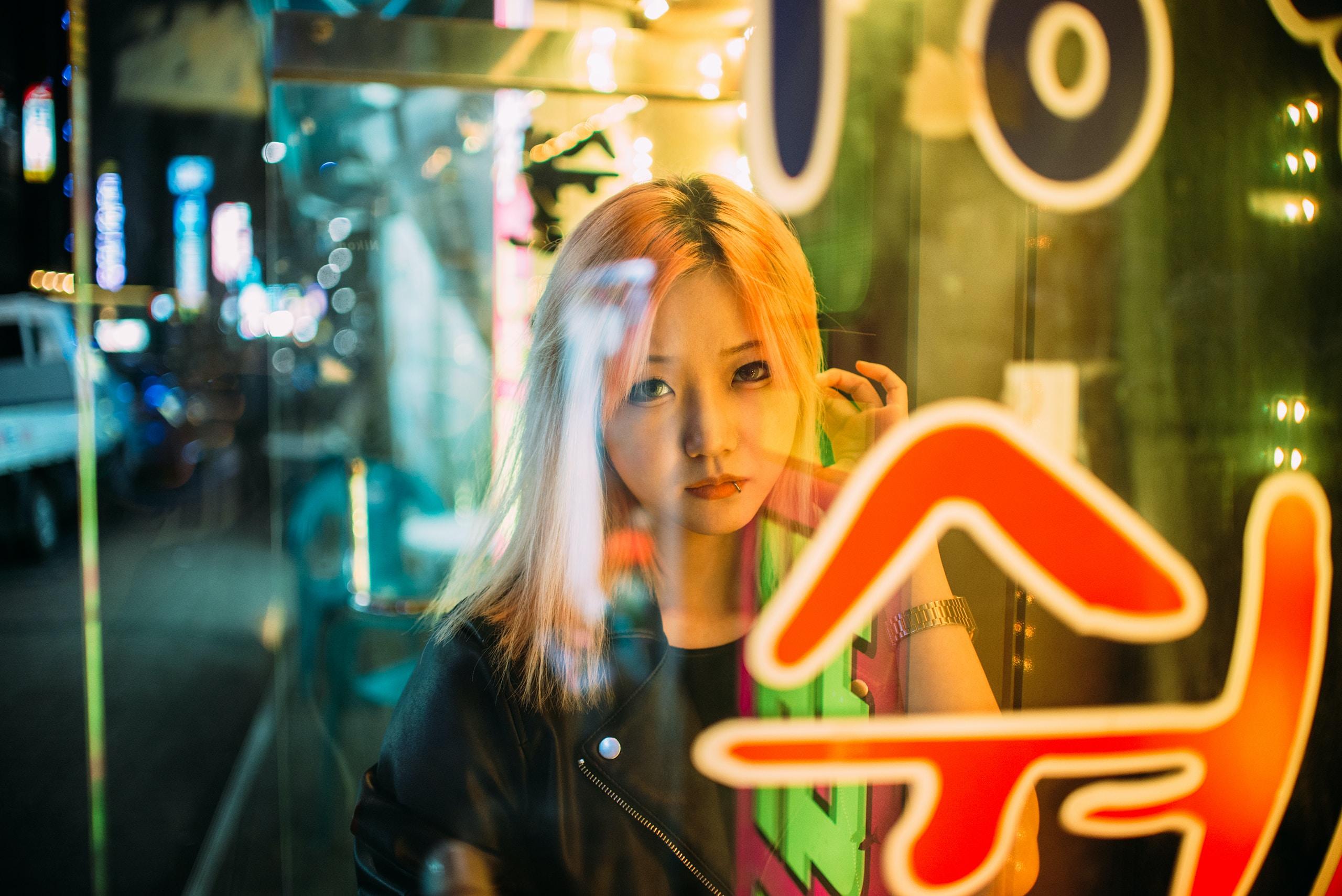 woman outside glass window