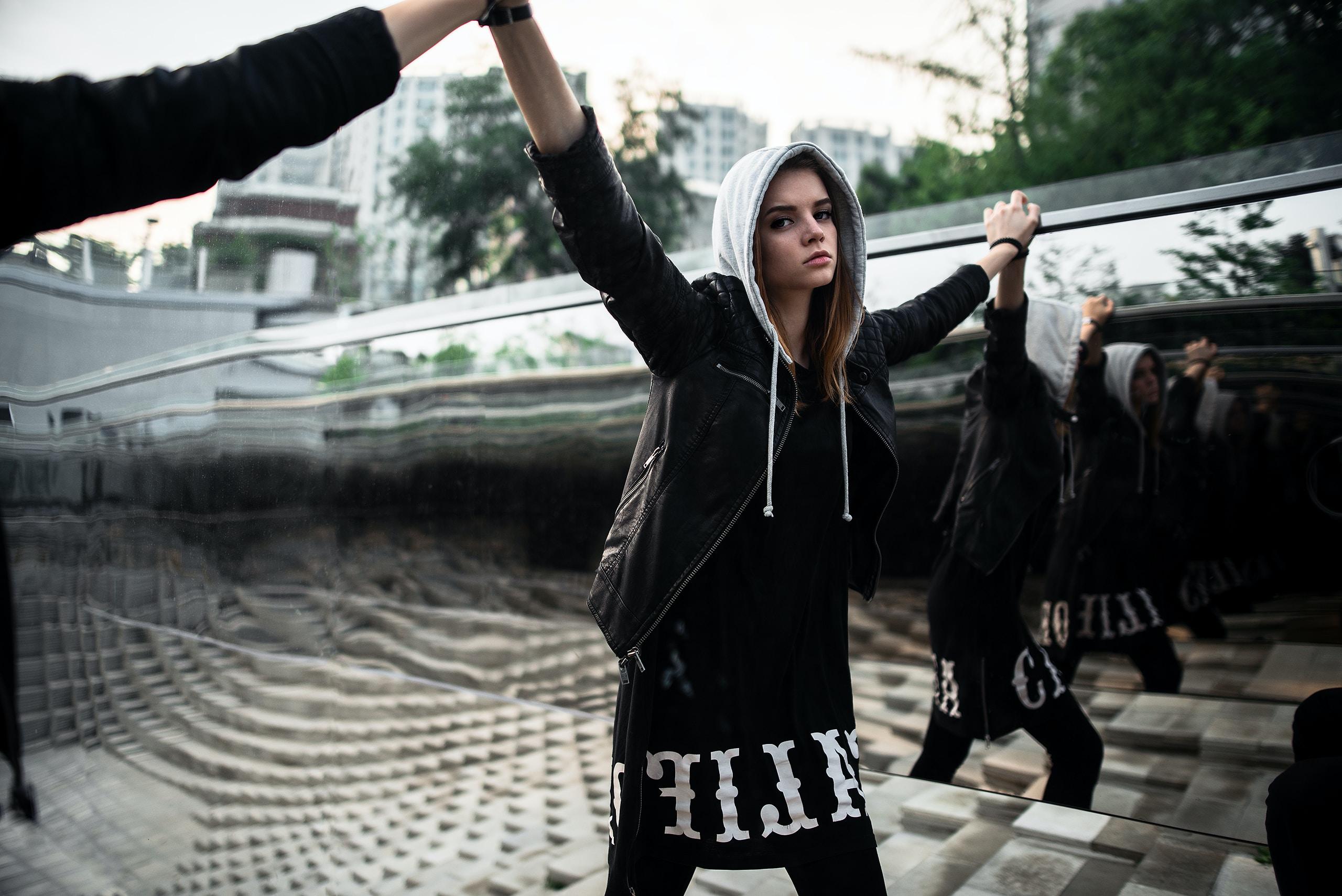 woman wearing black and gray hoodie