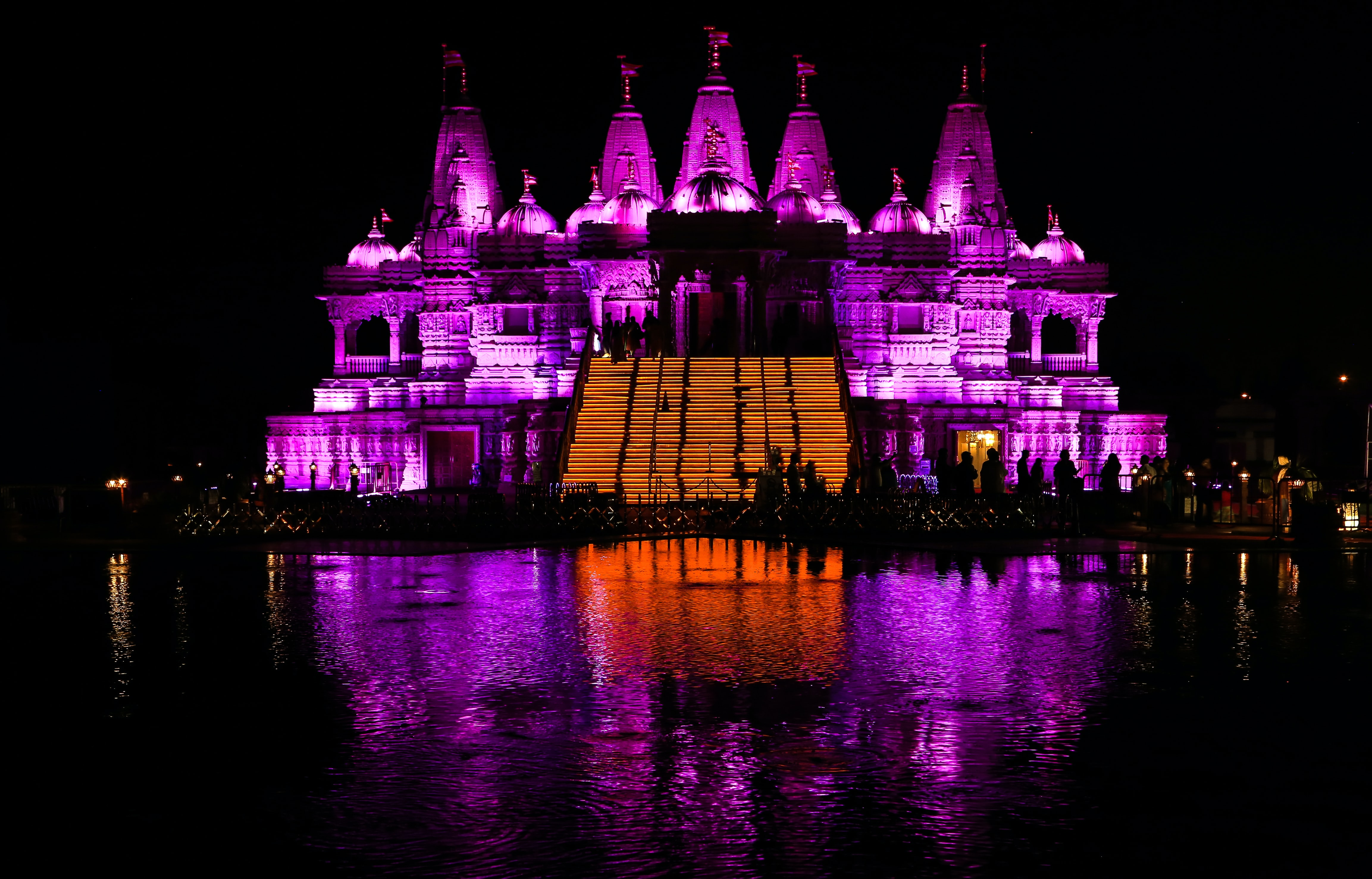building with pink and orange lights at night