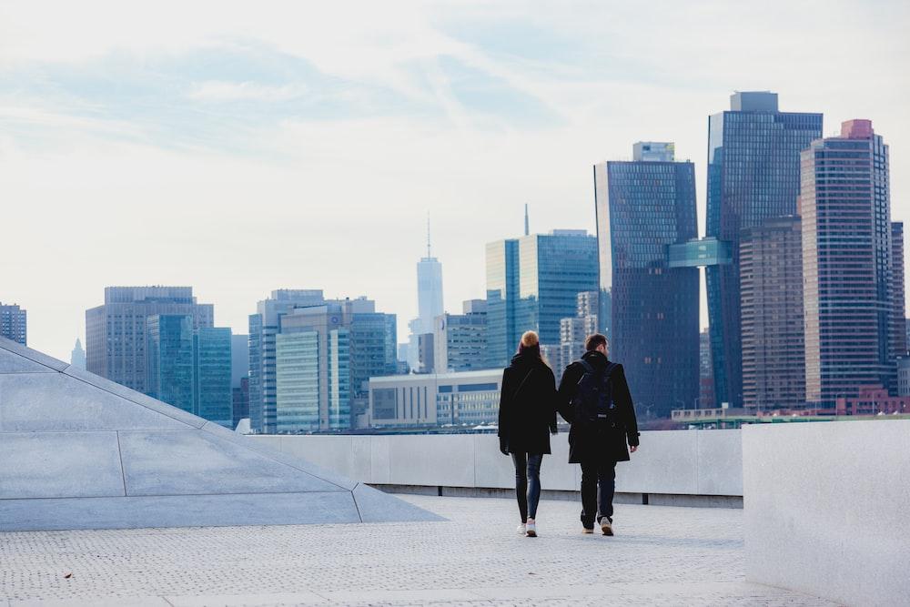 two people walking on rooftop
