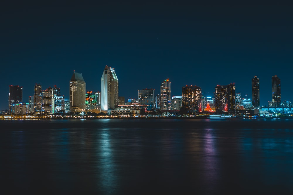 city near body of water during nighttime