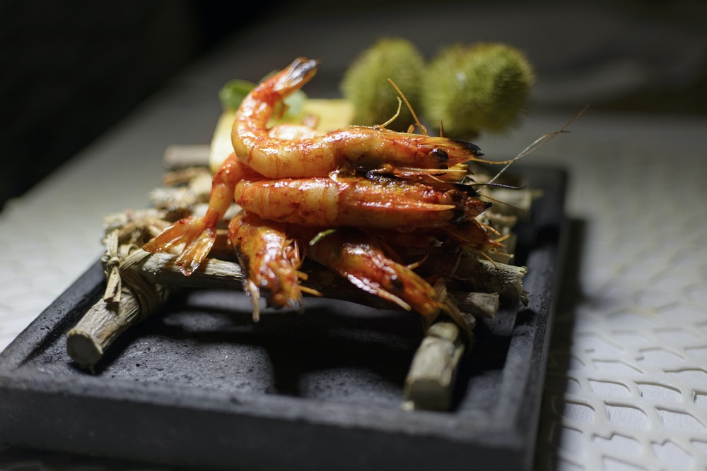 cooked prawns on bamboo stick
