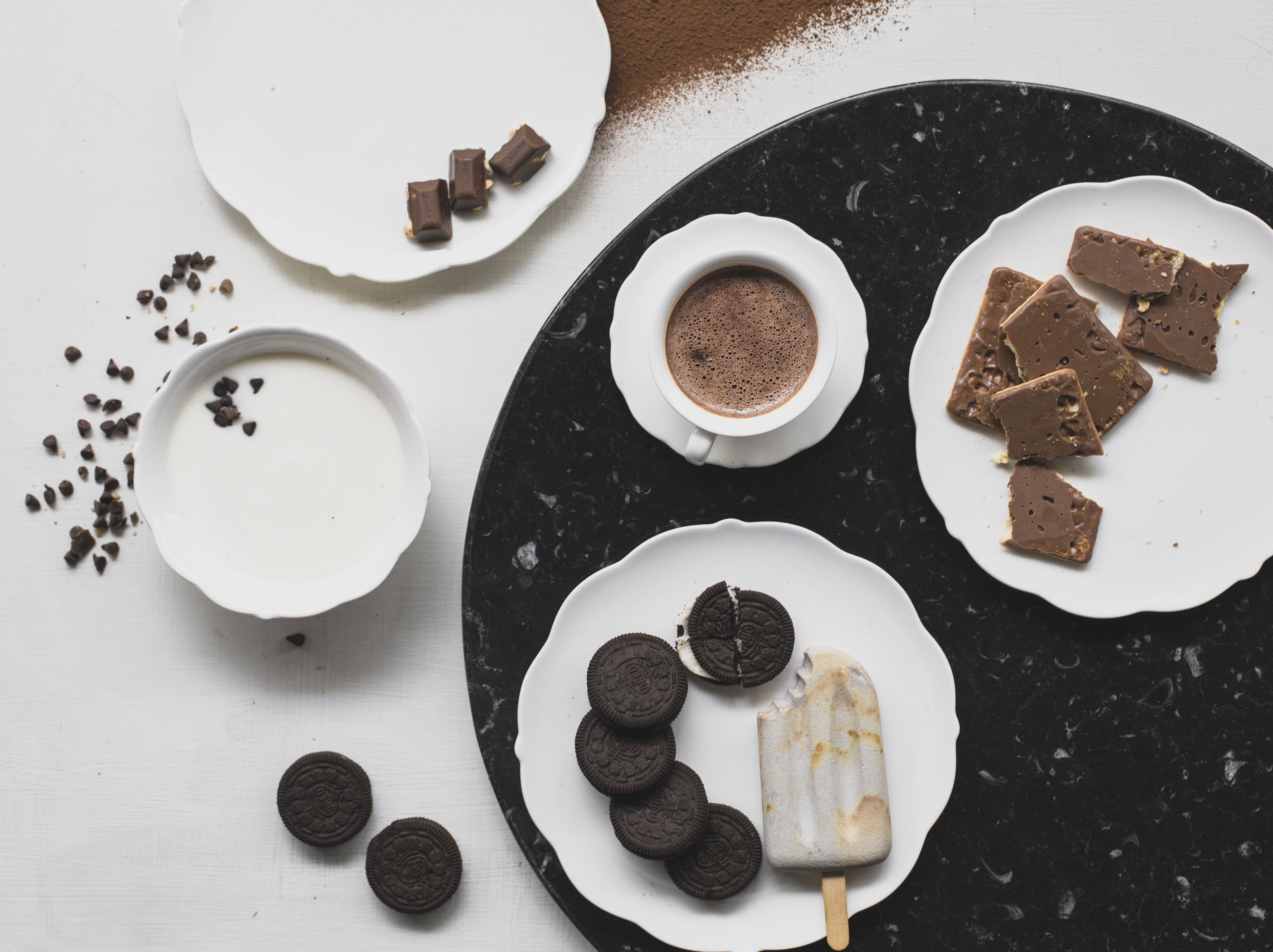 cookies on white ceramic plate with ice cream and chocolate drink