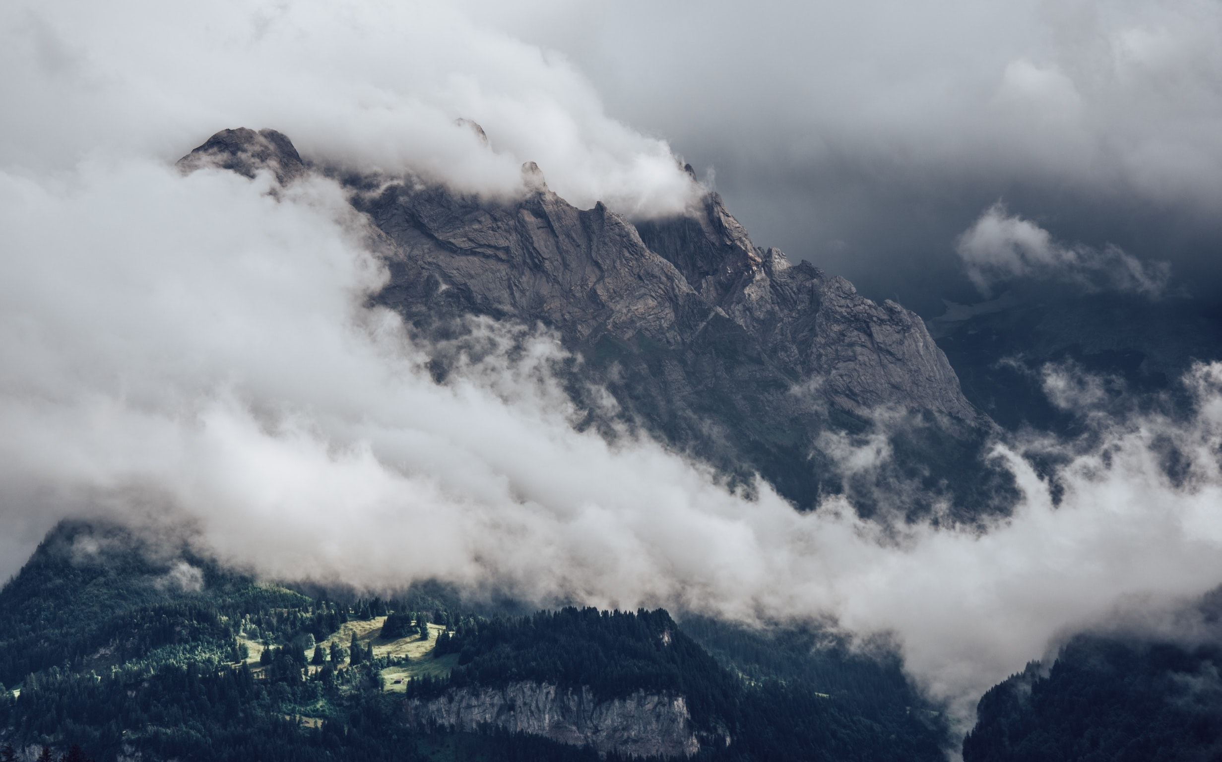 photo of mountain covered with clouds