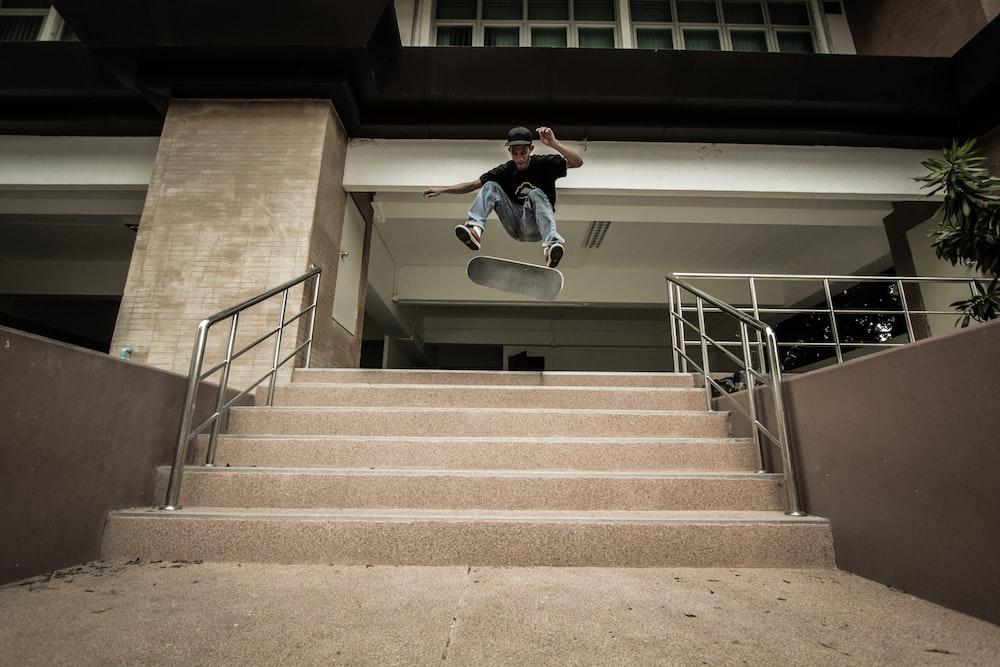 man doing skate on stairway