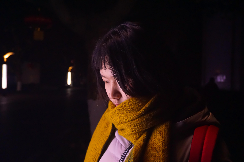 woman wearing yellow corduroy scarf