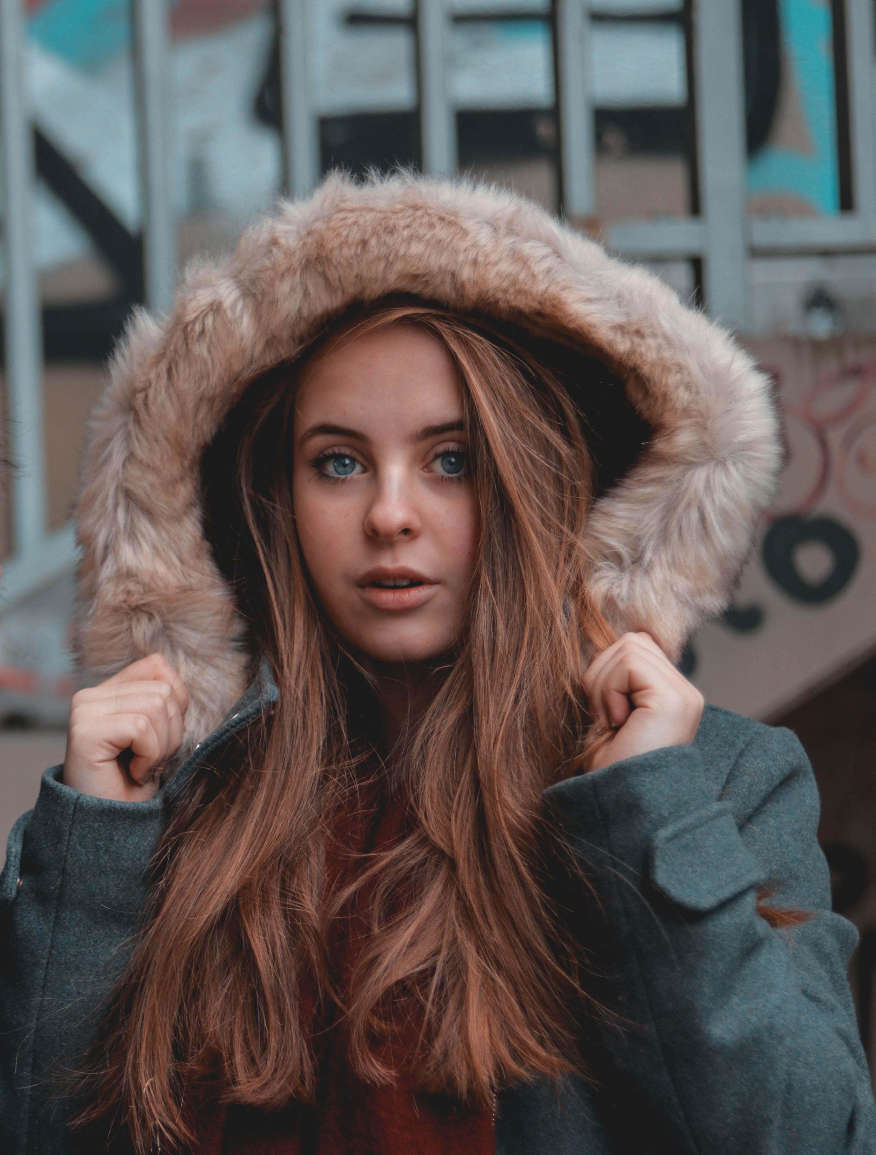 woman wearing gray hooded parka jacket
