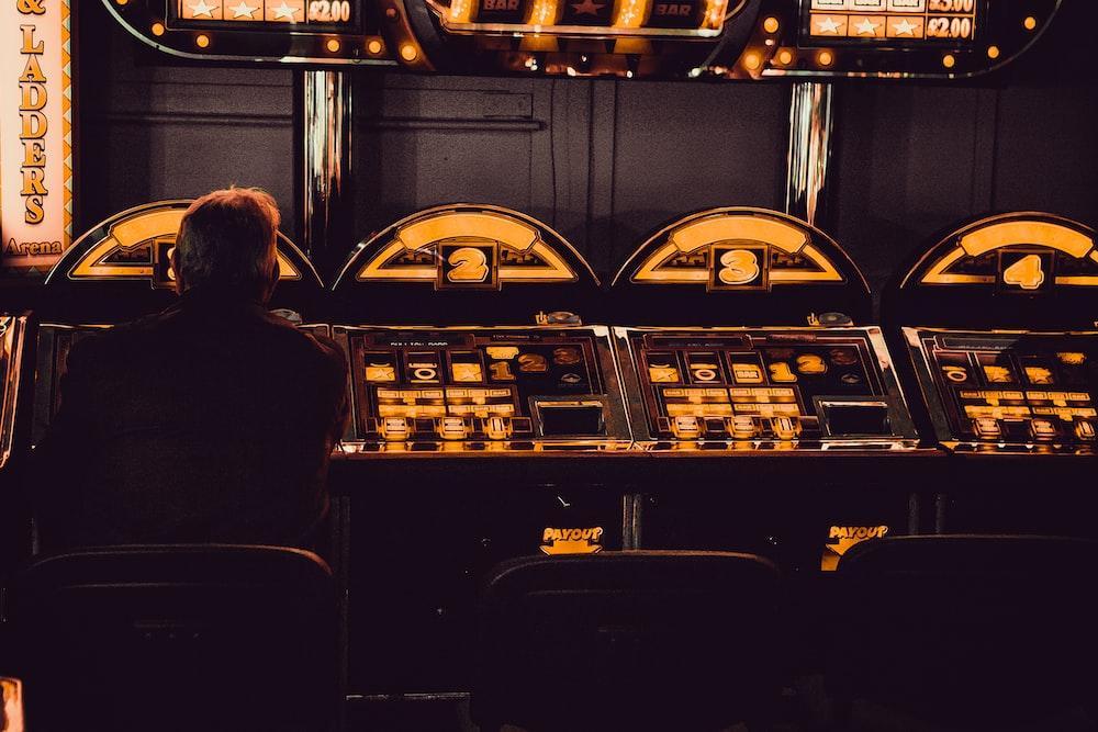man playing arcade machine