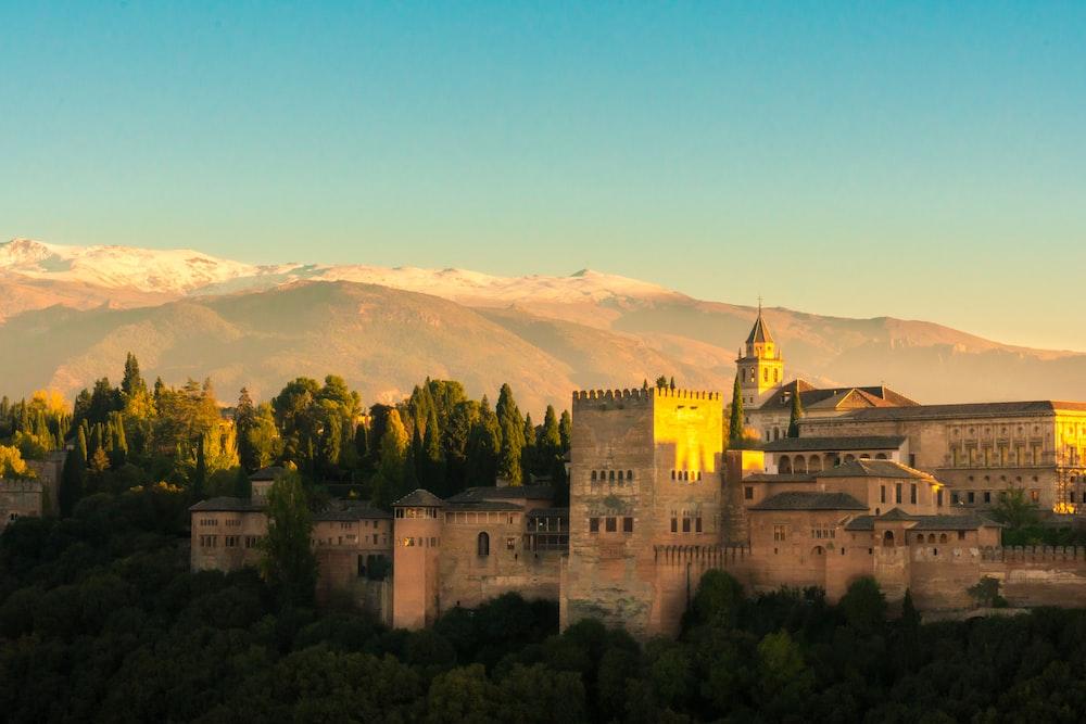 beige castle within mountain range