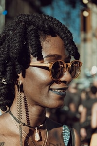 woman with braided hair wearing brown sunglasses