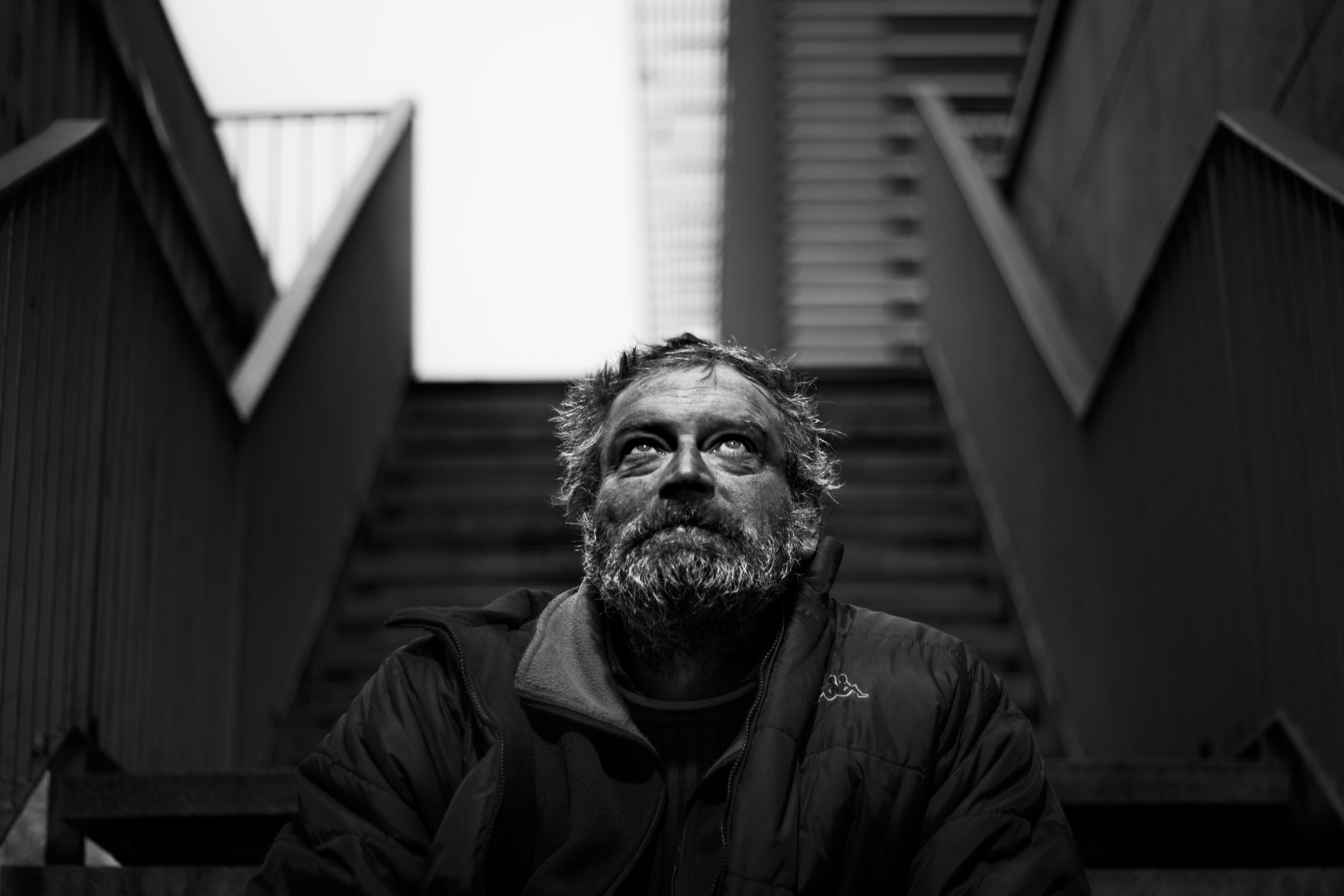 grayscale photography of man wearing black jacket