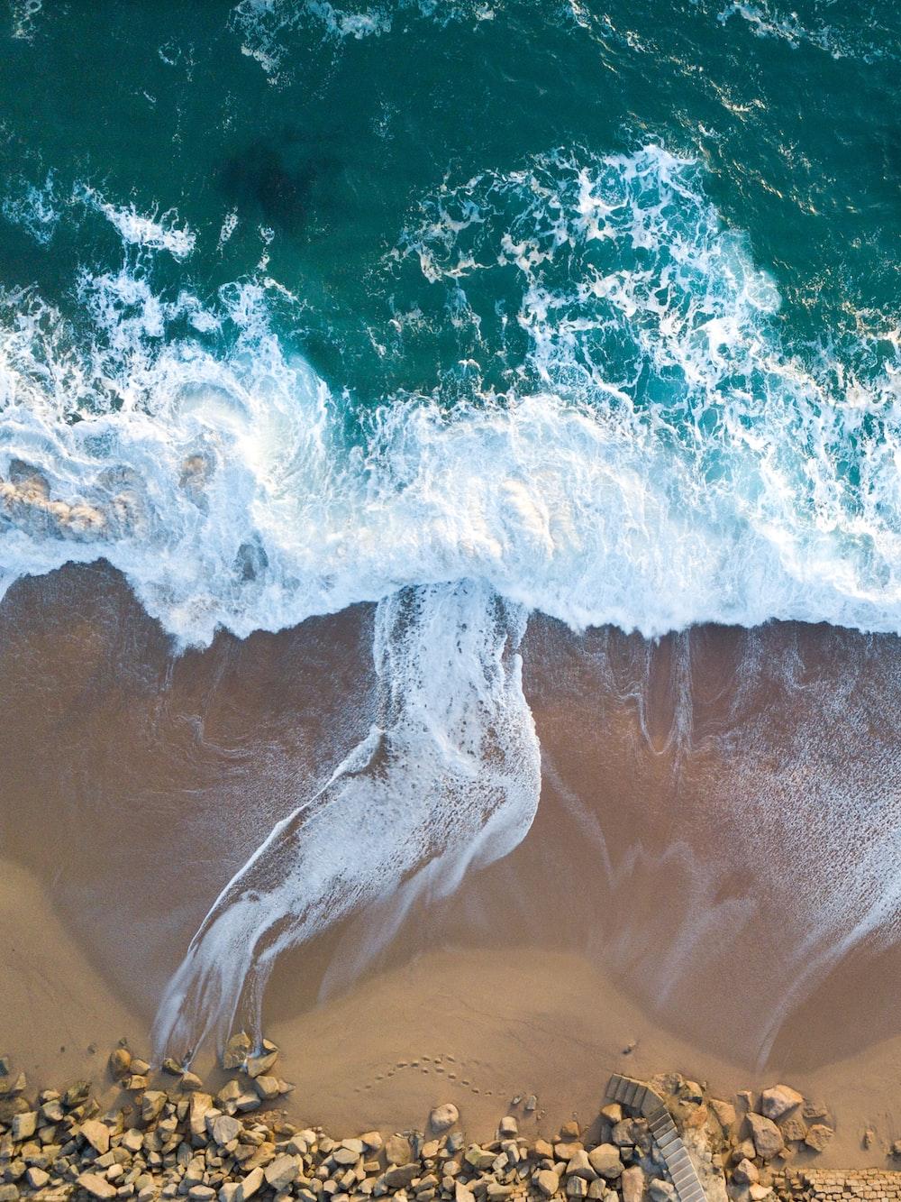 top view of ocean wave on seashore