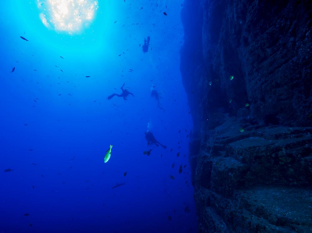 three people performing ocean diving