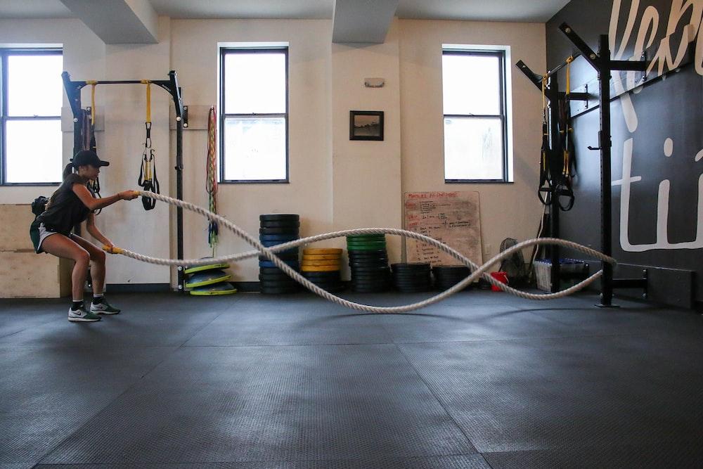 woman holding exercise using training rope