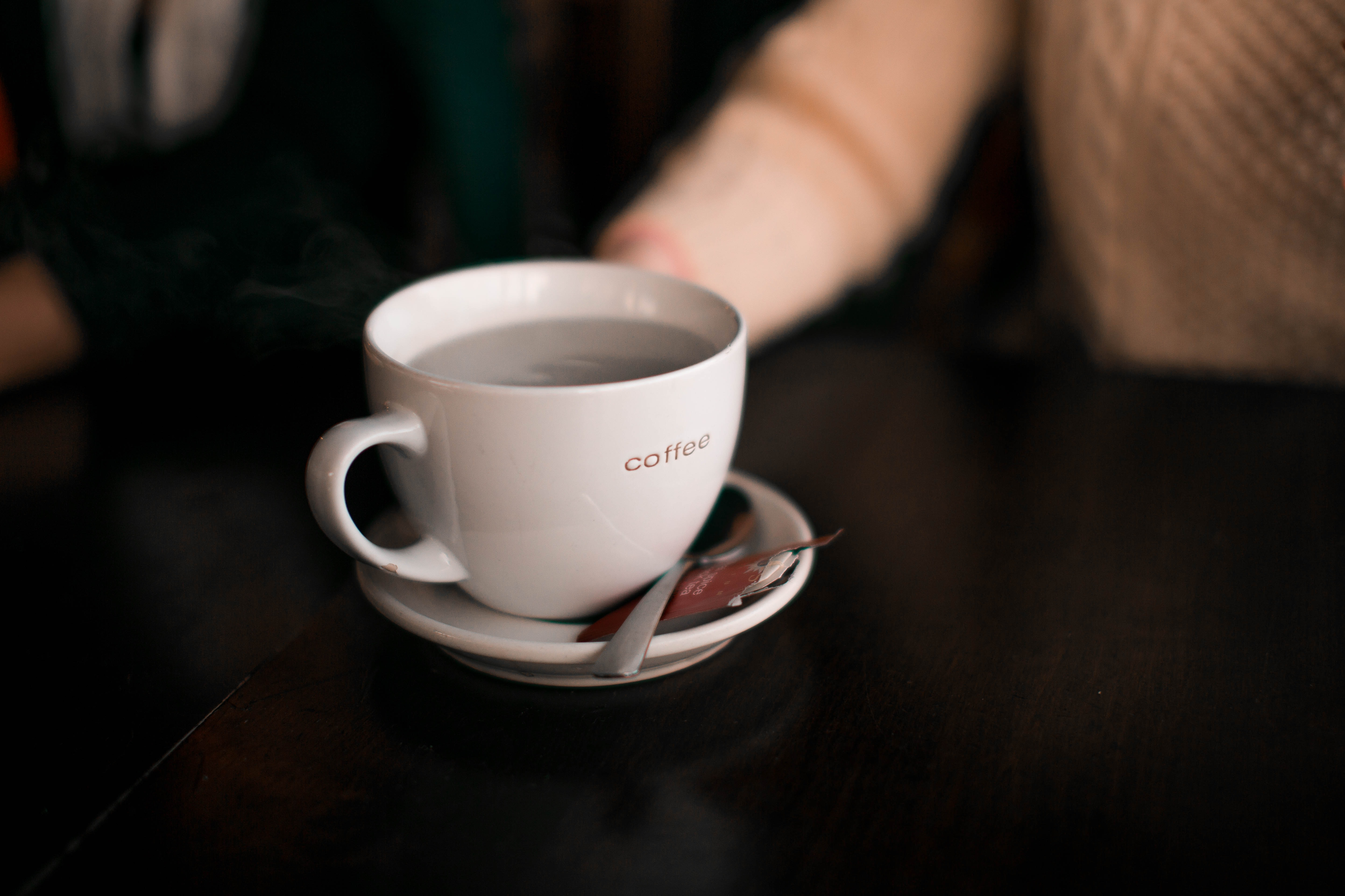 shallow focus photography of coffee cup