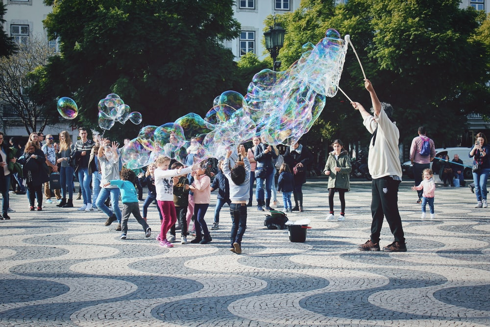 group of people playing bubble at park